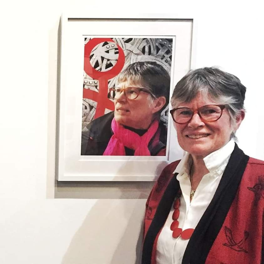 Founder of Women Transforming Cities and former city councillor Ellen Woodsworth stands with her portrait